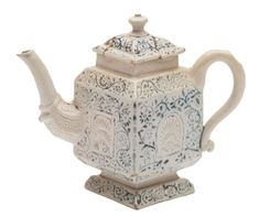 Staffordshire scratch-blue salt glaze teapot and cover: of diamond shape,5 ins high sold in U.K. £880 2018.(A/F Lid) Examples in the V & A Museum ,London.