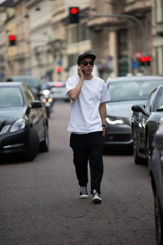 Here's the white shirt done right. Layered & and slightly oversized. (Eugene Tong)