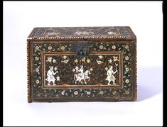 Fall-front cabinet, teak veneered with rosewood and inlaid with tropical woods, ivory and brass, decorated hunting scenes. Gujarat or Sindh, early 17th century