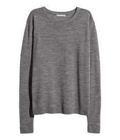 Jersey de punto fino en lana de merino con mangas largas.