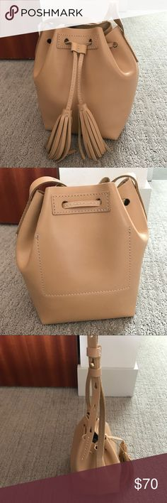 "J Crew mini bucket bag leather LIKE NEW 8 3/8""H x 5 3/4""W x 5 1/4""D. Adjustable shoulder strap fully extends to 24"" shoulder drop. Crafted in a smooth, structured leather and features a tassel drawstring closure and a handy interior pocket (so you don't have to dig for your ID/lipstick/phone).  Genuine leather. Unlined. J. Crew Bags Shoulder Bags"