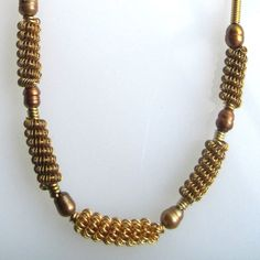 Gold Wire Coil and Pearl Necklace by SarahsArtisanJewelry on Etsy, $40.00