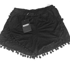 NWT - Super cute black pompom jersey runner shorts New and unworn super soft black Pom Pom shorts, Mid to high waist with elastic waist. Too big for me but perfect for festival wear! Missguided Shorts