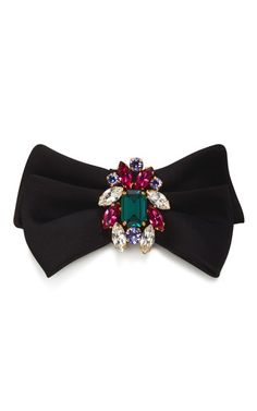 Dolce & Gabbana's hair clip features a black satin bow that's ornately embellished with an array of jewel-toned crystals. Wear yours to give looks the perfect feminine finish.