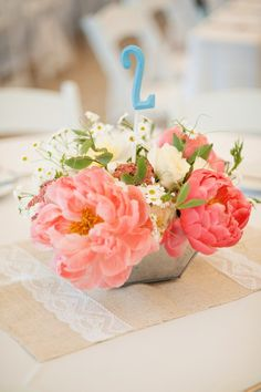whimsical centerpieces with table numbers via Style Me Pretty