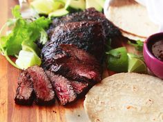 Regardless of the exact flavors I ended up using in my recipe, we can all agree on a few things here. Great carne asada should taste, first, of the beef. It should be buttery, rich, and juicy, with a charred, smoky flavor. It should be tender enough to fill a taco or burrito, but substantial enough to be served as a steak. Finally, the marinade should have a good balance of flavors, with no single ingredient overwhelming any other.