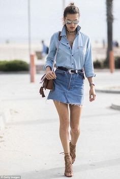 Alessandra ambrosio in double denim outfit with chambray shirt and distressed denim skit