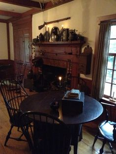 Windsor chairs, a lift top game table, old pewter over the mantle and an 1836 musket. What could be better!