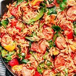 This Italian Orzo and Sausage Skillet is a quick and easy meal filled with Italian spices sausage peppers spinach and orzo all in a rich tomato sauce direct link in profile therecipecritic dinner oneskillet orzo italian huffposttaste foodandwine buzzfeedfood bhgfood eeeeeats buzzfeast foodgawker foodforfoodies thekitchn todayfood sponsored