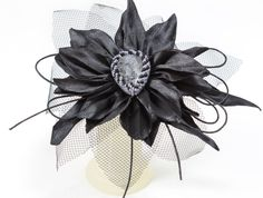 A personal favourite from my Etsy shop https://www.etsy.com/ie/listing/564244346/fab-big-black-kanzashi-flower-hair