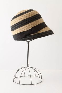 """Heat Season Cloche   Summertime is here in jaunty jute finished with a grosgrain swirl. Jute 24"""" crown, 2.25"""" brim Imported style #20530770 $48.00"""