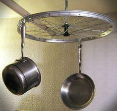 Space-saving bicycle wheel pot/pan hanger
