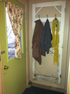 """I thought this was """"pinterest-y"""".. My boyfriend and I salvaged an old door from an abandoned house, distressed it, and hung world market hooks on it, then hung it on my wall by the back door as a coat rack. Curtains from world market as well. Love."""
