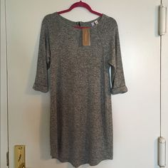 Light grey dress/tunic Never worn dress from Francesca's- tags still on! Size medium, 3/4 length sleeves, partial zipper on back Francesca's Collections Dresses Midi