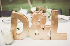 A great wedding reception decoration piece for a typography inspired reception.