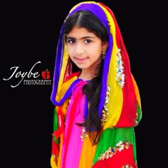Jena is wearing a colorful Bahrain traditional dress. This was taken during our celebration of National Day.