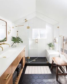 bright bathroom // hexagon floor tiles // glass shower // wood and white vanity