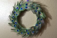 Peacock feathers are brilliantly colored in jewel-toned shades of turquoise, purple, blue and gold. If you enjoy decorating your home in jewel tones, you can use peacock feathers to complement and accent your decor. One way to decorate with peacock feathers is to use the feathers to create a beautiful peacock wreath. When you're done, you can show...
