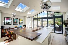 open plan kitchen living area in roof Kitchen Extension Lighting, Kitchen Diner Extension, Kitchen Lighting, Floor To Ceiling Windows, House Windows, Big Windows, Roof Design, House Design, Condo Design