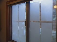 I saw this idea on HGTV on a sliding glass door, but they frosted the opposite parts of the glass.