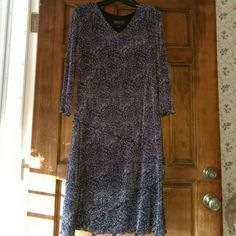 Beautiful flirty stretch v neck midi dress Layered diagonal flirty dress sleeves are till elbows great for any occasion worn once price negotiable with offer button colors are purple black white Dresses Midi