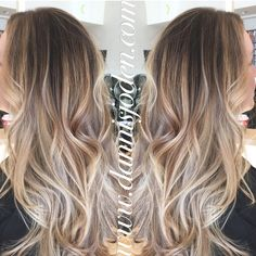 Neutral blonde balayage ombré with a long layered haircut & beach waves! Hair by Danni in Denver, CO