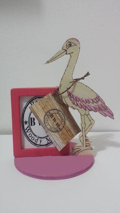 Porta foto in legno fatto a mano, ideale come bomboniere per battesimo. I colori posso essere personalizzati e sulla base si può pirografie il nome e la data del battesimo.