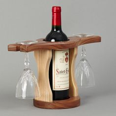 Resultado de imagem para wood wine glass holder over a wine bottle Wine Bottle Glass Holder, Wine Glass Holder, Wooden Wine Holder, Wine Rack Design, Wine Dispenser, Rustic Wine Racks, Woodworking Projects That Sell, Wine Carrier, Bottle Carrier