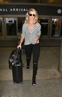 Stunning: Rosie Huntington-Whiteley didn't have even a hair out of place as she landed fro...