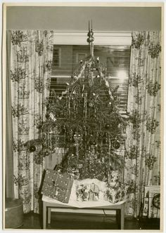 Vintage photo....c1940s Christmas Tree with Presents and 1940s Patterned Rayon Curtains.