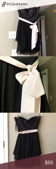Dress Worn once. Adorable black strapless dress with nude colored sash. From Francesca's boutique. The brand is Ark and Co. Dresses Strapless