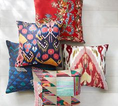 Bright colors and stylized blooms combine for a patterned pillow cover that…