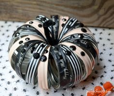 Glam is in. Learn how to make this studded & stripped pumpkin with your mason jar lids.