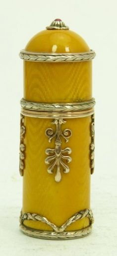 """Description RUSSIAN SILVER & GUILLOCHE COVERED BOX Measures 2-1/2"""" tall (6.35cm). Bears the Faberge mark. Beautiful yellow guilloche over heavy Russian silver, with silver trim. Stamped to base with the 84 Russian silver mark. Makers mark NHI. Height 2-1/2""""."""