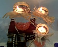Raffia Tied Jam Jars with floating candle.  www.blueorchid-events.com