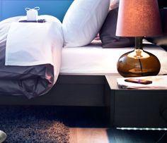 DIODER lighting strip attached under a bedside table
