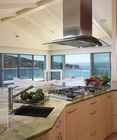 Contemporary Tiburon home - Contemporary - Kitchen - San Francisco - Mahoney Architects & Interiors Contemporary Kitchen, Kitchen Remodel, Island With Stove, Kitchen Design, Kitchen Ventilation, Kitchen Flooring, Kitchen Hood Design, Kitchen, Buying Kitchen Appliances