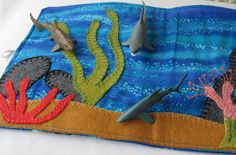 Mini Play Scene Pouch with Sharks   This quilted fabric Mini Play Scene Pouch with Sharks will keep your little ones amused for hours.