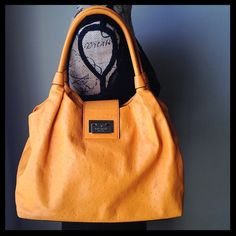 """Kate Spade Bexley """"Stevie"""" satchel *firm price* Beautiful orange Kate Spade satchel! Although it is Ostrich style, the bag exterior is 100% cow leather. Interior is polyester. Bag features;  -two open interior compartments -one interior zippered compartment -one interior side pocket with zipper enclosure. Zippers all work perfectly, and inside lining is pristine. No marks or inperfections of any kind inside bag. Please see extra listing photos for minor exterior marks. Approx. measurements…"""