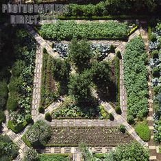 nice configuration for south garden- climbers and fruit next to brick walls, inner beds with veg, centre cutting garden, table The Potager at Barnsley House