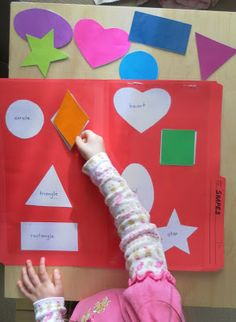 We chose this activity because it is something that the students can do independently to practice matching and naming shapes that has an easy set up and clean up.  This activity benefits children through providing them an opportunity to match eight different cutouts of shapes into the correct spot on the folder. In the classroom, this activity could be used as an assessment to see the students' current ability to match the shape cut out with the correct place in the folder.