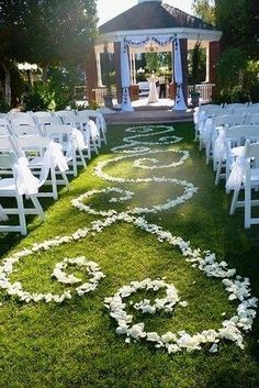 Romantic aisle runner out of rose petals. Awesome idea and Soo cute!