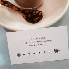Loyalty cards hot off the press. Purchase 7 coffee's and the 8th one is on us! Loyalty cards now available @Happy Bones NYC