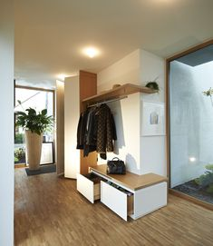 This wardrobe is built in corner. The surface is painted white matt and made of multiplex oak veneer. The cupboard is … - New Deko Sites Entrance Foyer, Entrance Design, House Entrance, Entryway Decor, Interior And Exterior, Interior Design, Foyer Decorating, Mudroom, New Homes