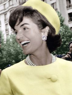 Jackie in a yellow coat and hat.