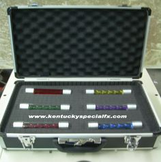 The fancy transport case is a inner foam lined case sporting all six of the original T-Virus, Anti Virus, Uroburos ( Las Plagas ), Nemesis Virus, Code Veronica Virus and Wesker Virus Vials! All six resident evil vial prop replicas ever presented in  Yes all six Resident Evil virus vial movie and game prop replicas are included. Outer case measures 18 x 13 x 6 inches and comes complete with two real locking latches with keys. All vials measure six inches long and a inch and a quarter round.