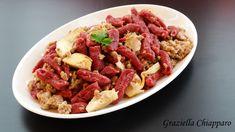Cavatelli+alla+barbabietola+con+ragù+bianco+ai+carciofi