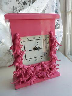 pink dinosaur clock