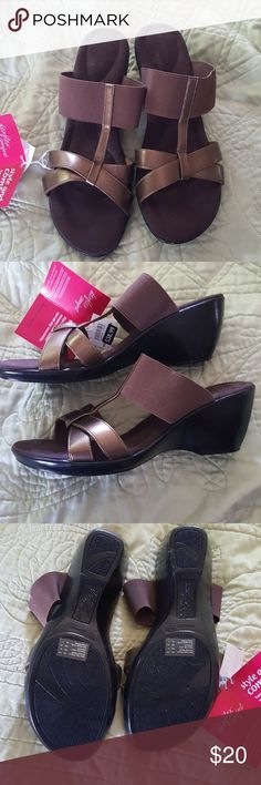 Super comfy Dexflex wedges 9.5W These bronze beauties are looking for some new feet! BNWT the upper portion is elastic so that makes them too big for me. I had another pair that I donated so I would stop wearing them. Definitely wide width! Dexflex comfort from Payless. Shoes Wedges