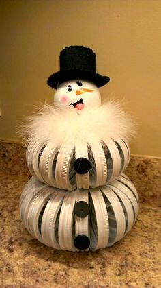 snowman made out of canning rings: